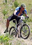 Darrel Lowe lifts a leg. Mammoth Adventure MTB Ride, Nelson<br /> Photo: Marc Palmano/shuttersport.co.nz