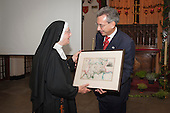 Councillor Robert Davis, Deputy Leader, Westminster City Council, presents a gift to Mother Xavier McMonagle, Assistant Superior General, Tyburn Convent.   Restoration of the Tyburn Tree Plaque at the junction of Edgware Road and Marble Arch, London.