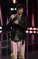 """HOLLYWOOD, CA - MAY 27: Josh Dun of Twenty One Pilots accepts Alternative Rock Song & Artist of the Year Award at the 2021 """"iHeartRadio Music Awards"""" airing live from The Dolby Theatre in Los Angeles, Thursday, May 27 (8:00-10:00 PM ET live / PT tape-delayed) on FOX.  (Photo by Frank Micelotta/FOX/PictureGroup)"""