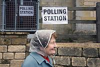 An elderly woman leaves a polling station after casting her vote during the Nailsworth Parish council elections in Gloucestershire.