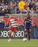 FC Dallas midfielder Andre Rocha (11) brings ball forward as New England Revolution forward Kheli Dube (11) defends. The New England Revolution defeated FC Dallas, 2-1, at Gillette Stadium on April 4, 2009. Photo by Andrew Katsampes /isiphotos.com