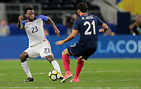 Arlington, TX - Saturday July 22, 2017: Kellyn Acosta and Marco Ureña during a 2017 Gold Cup Semifinal match between the men's national teams of the United States (USA) and Costa Rica (CRC) at AT&T stadium.
