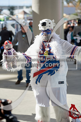 A decked out Buffalo Bills fan poses for photos before an NFL Wild-Card football game against the Jacksonville Jaguars, Sunday, January 7, 2018, in Jacksonville, Fla.  (Mike Janes Photography)