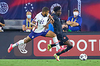 5th September 2021; Nashville, TN, USA;  United States defender DeAndre Yedlin challenges Canada defender Alphonso Davies (19) during a CONCACAF World Cup qualifying match between the United States and Canada on September 5, 2021 at Nissan Stadium in Nashville, TN.