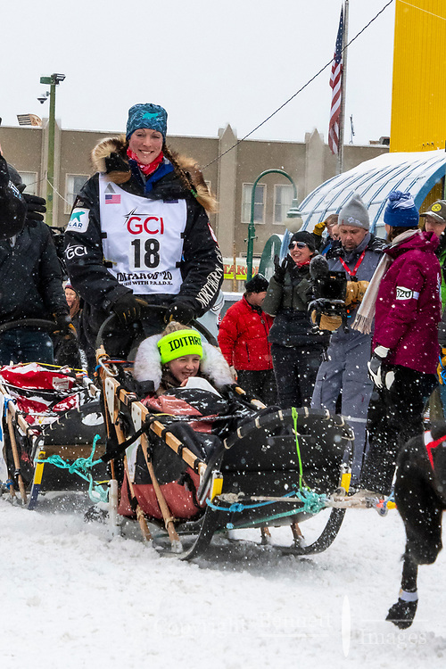 Anna Berington and team leave the ceremonial start line with an Iditarider and handler at 4th Avenue and D street in downtown Anchorage, Alaska on Saturday March 7th during the 2020 Iditarod race. Photo copyright by Cathy Hart Photography.com