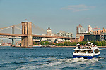 NY Waterway ferry boat on the East River with the Williamsburg Bridge and Brooklyn Bridge in the background