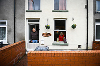 Flooding effected the villages of Aberdulais and Tonna in the Neath Valley after Storm Callum brought heavy rain and wind to the area cuasing the River Neath to reach bursting point. <br /> A couple look out from their property at Canal Side, Tonna, Neath. Saturday 13 October 2018