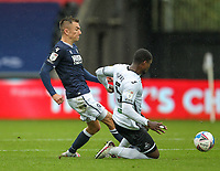 3rd October 2020; Liberty Stadium, Swansea, Glamorgan, Wales; English Football League Championship, Swansea City versus Millwall; Jed Wallace of Millwall is tackled by Marc Guehi of Swansea City