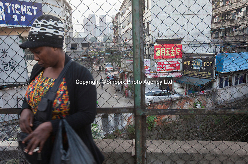 An African woman is seen in an area of Guangzhou known to locals as 'Chocolate City', Guangzhou, Guangdong Province, China, 08 December 2014. The health authorities of Guangzhou are said to be stepping up their monitoring of the African community in light of the ongoing outbreak of the Ebola virus disease in West Africa.