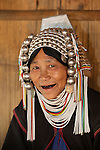 Myanmar, (Burma), Shan State, Kengtung: Loimi-Akha woman with headdress and betel stained teeth | Myanmar (Birma), Shan Staat, Kengtung: Frau des Loimi-Akha Volksstammes traegt prachtvollen, silbernen Haarschmuck, die Zaehne sind vom Betelnuss kauen dunkel