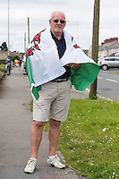 STORY BY STEVEN MORRIS SWANSEA, UK. 5th July 2015. Delivery driver William Jones, poses with a Welsh flag in Mayhill, the area of Swansea that Wales manager Chris Coleman comes from.