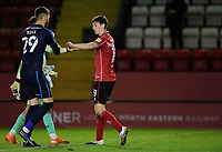 Lincoln City's Ethan Ross, left, with team-mate Conor McGrandles following the game<br /> <br /> Photographer Chris Vaughan/CameraSport<br /> <br /> EFL Papa John's Trophy - Northern Section - Group E - Lincoln City v Manchester City U21 - Tuesday 17th November 2020 - LNER Stadium - Lincoln<br />  <br /> World Copyright © 2020 CameraSport. All rights reserved. 43 Linden Ave. Countesthorpe. Leicester. England. LE8 5PG - Tel: +44 (0) 116 277 4147 - admin@camerasport.com - www.camerasport.com