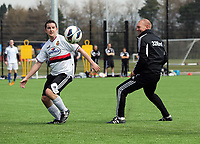 Thursday 11 April 2013<br /> Pictured L-R: Swansea City press officer Chris Barney against goalkeepeing coach Adrian Tucker.<br /> Re: Friendly game, Swansea City FC coaching staff v sports reporters at the Swansea City FC training ground. Final score 10-4.