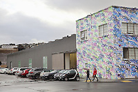 USA. California state. San Francisco. Potero Hill district.  Fuseproject offices with graffitis from the street artist Jesso. Yves Béhar (born 1967) is a Swiss designer, renowned entrepreneur, and sustainability advocate. He is the founder and principal designer of Fuseproject, an award-winning industrial design and brand development firm. Béhar is also Chief Creative Officer of the wearable technology company Jawbone, and Co-founder and Chief Creative Officer of August, a Smart Lock maker. Béhar's design work emphasizes the integration of commercial products with sustainability and social good. His clients have included Herman Miller, PUMA, MINI, See Better to Learn Better, General Electric, Swarovski, Samsung, Jimmyjane, and Prada. He is the chief industrial designer of One Laptop per Child (OLPC's) XO laptop, signing on with the project in 2005 and has been with the team since March 2006. This collaboration has led to two additional laptop prototypes, the OLPC XOXO and OLPC XO-3. In 2012 SodaStream International teamed with Béhar to introduce Source, a new home soda machine designed with a special emphasis on sustainability. 15.12.2014 © 2014 Didier Ruef