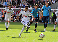Pictured: Scott Sinclair of Swansea scores the first Premiership goal for his team from the penalty spot. Saturday 17 September 2011<br /> Re: Premiership football Swansea City FC v West Bromwich Albion at the Liberty Stadium, south Wales.