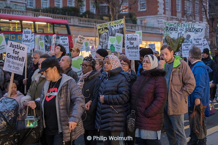 Monthly silent march commemorating victims of the Grenfell Tower fire, Kensington High Street, London.