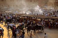 Crowded market in Djemaa el Fna, Marrakesh, Morocco.