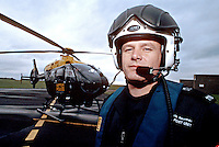 Police air support unit officer with police air ambulance helicopter. This image may only be used to portray the subject in a positive manner..©shoutpictures.com..john@shoutpictures.com