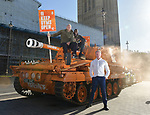 Pictured:  James Haskell and Paul Olima stand ontop of the Grenade® tank outside the Houses of Parliament with Ilford South MP Sam Tarry in protest of #KeepingGymsOpen during the second Coronavirus lockdown that starts tomorrow in England.<br /> <br /> A bright orange tank driven by England rugby star James Haskell headed to Parliament Square today and caused a ruckus as it was stopped by police.  The former international was joining performance nutrition brand Grenade in protesting gyms and leisure centres being classified as 'non-essential' under new lockdown regulations.<br /> <br /> There were a reported 22 million visits to gyms after they reopened in July, with just 78 Covid cases being tracked to these locations.  With England set to return to a nationwide lockdown from tomorrow (Thursday November 4) these leisure facilities will once again be forced to close, not being classed as 'essential'. SEE OUR COPY FOR DETAILS<br /> <br /> © Solent News & Photo Agency<br /> UK +44 (0) 2380 458800