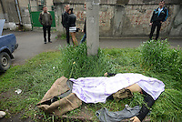 The corpse of a civilian shot dead lies in the street nearby the Mariupol police headquarters. <br /> <br /> Ukraine's security forces claimed to have killed 21 pro-Russian separatists in Mariupol on one of the bloodiest military repression since the so called anti-terror operation's inception.