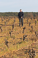 Thierry Rodriguez Domaine Mas Gabinele. Faugeres. Languedoc. Vines trained in Gobelet pruning. Terroir soil. Owner winemaker. In the vineyard. France. Europe.