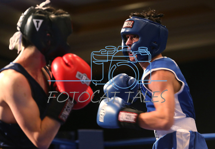 Nevada boxer Jonny Mancilla and Jason Lan, of Cal, compete in the National Collegiate Boxing Association action in Reno, Nev. on Friday, Jan. 31, 2020. Mancilla won the bout. <br /> Photo by Cathleen Allison