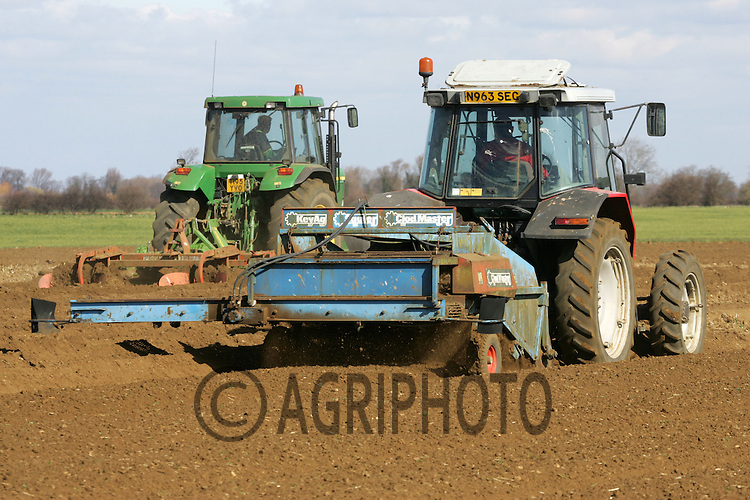 Tractors stone separating ready for planting potatoes