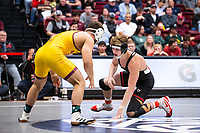 STANFORD, CA - March 7, 2020: Joshua Shields of Arizona State University and Shane Griffith of Stanford during the 2020 Pac-12 Wrestling Championships at Maples Pavilion.