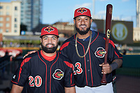 Wilin Rosario (20) and Jordany Valdespin (23) of the Rochester Red Wings pose for a photo prior to the game against the Charlotte Knights at BB&T BallPark on May 14, 2019 in Charlotte, North Carolina. The Knights defeated the Red Wings 13-7. (Brian Westerholt/Four Seam Images)