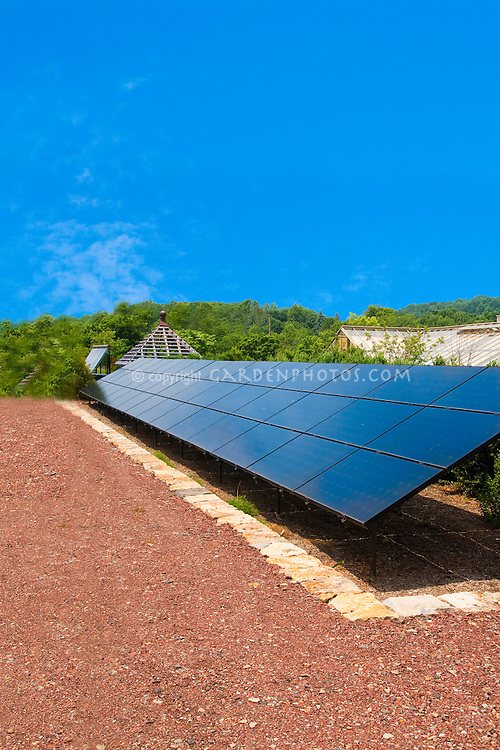 Large Solar Panel on homestead farm, sunny day, blue skies, red clay soil