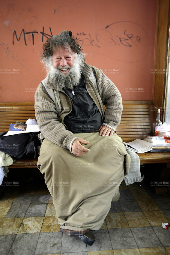 Switzerland. Geneva. Poverty in Geneva. Douba is a swiss from the Valais state and is 50 years old. He is homeless and sits on a public bus stop's bench in the Eaux-Vives area.  He spends most of his days and nights at the same place. © 2005 Didier Ruef