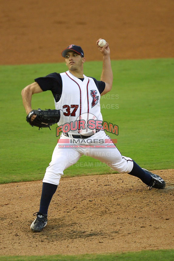 Houston Astros pitcher Andy Pettitte (37) delivers a pitch to the plate during his second rehab start with the Round Rock Express of the Texas League on June 23, 2004 at the Dell Diamond in Round Rock, Texas. (Andrew Woolley/Four Seam Images)
