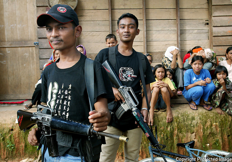 Acehnese rebels, known as the Free Aceh Movement, control a village in Lamno, Indonesia on  January 14, 2005.  (photo by Khampha Bouaphanh)