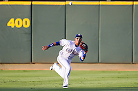 Round Rock Express outfielder Leonys Martin #27 makes a diving catch during the Pacific Coast League baseball game against the Nashville Sounds on August 26th, 2012 at the Dell Diamond in Round Rock, Texas. The Sounds defeated the Express 11-5. (Andrew Woolley/Four Seam Images)..