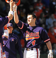 Infielder John Hinson (4) of the Clemson Tigers scores a run in a game against the Michigan State Spartans Saturday, Feb. 20, 2010, at Fluor Field at the West End in Greenville, S.C. Photo by: Tom Priddy/Four Seam Images