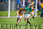 Jack Sheehan of Abbeydorney been tackled for possession by Kevin Goulding of Ballyduff in the Minor Hurling Championship semi final.