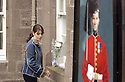 25/03/2003                   Copright Pic : James Stewart.File Name : stewart-black watch 02.AN UNIDENTIFIED GIRL LEAVES FLOWERS OUTSIDE THE BLACK WATCH REGIMENTAL HQ IN PERTH....James Stewart Photo Agency, 19 Carronlea Drive, Falkirk. FK2 8DN      Vat Reg No. 607 6932 25.Office     : +44 (0)1324 570906     .Mobile  : +44 (0)7721 416997.Fax         :  +44 (0)1324 570906.E-mail  :  jim@jspa.co.uk.If you require further information then contact Jim Stewart on any of the numbers above.........