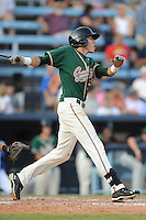 Greensboro Grasshoppers center fielder Christian Yelich #7 swings at a pitch during the first game of a double header against the Asheville Tourists at McCormick Field on July 26, 2011 in Asheville, North Carolina. Asheville won the game 12-4.   (Tony Farlow/Four Seam Images)
