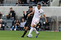 LOS ANGELES, CA - MARCH 01: Ben Sweat #22 of Inter Miami CF advances the ball as Diego Rossi #9 of LAFC defends during a game between Inter Miami CF and Los Angeles FC at Banc of California Stadium on March 01, 2020 in Los Angeles, California.