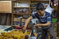 Yogyakarta, Java, Indonesia.  Vendor Selling Rock Sugar, made from Palm Sugar, Beringharjo Market.