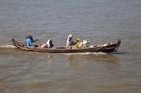 Myanmar, Burma.  Mingun, near Mandalay.  Small Boat on the Ayeyarwady Taking Two Women to or from Market.