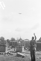Photo from the NIOD's Huizinga collection. Allied bombers fly low over The Hague because of their assignment to drop food packages above Duindigt.