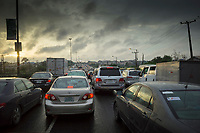Nigeria. Lagos. Traffic jam on the late afternoon. Lagos is a city in the Nigerian state of the same name. The city, with its adjoining conurbation, is the most populous in Nigeria and on the African continent. It is one of the fastest growing cities in the world and one of the most populous urban areas. 26.06.19 © 2019 Didier Ruef