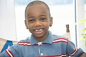 MR / Schenectady, NY. Zoller Elementary School (urban public school). Kindergarten classroom. Portrait of student (boy, 5) smiling with missing front baby teeth. MR: Abd2. ID: AM-gKw. © Ellen B. Senisi.