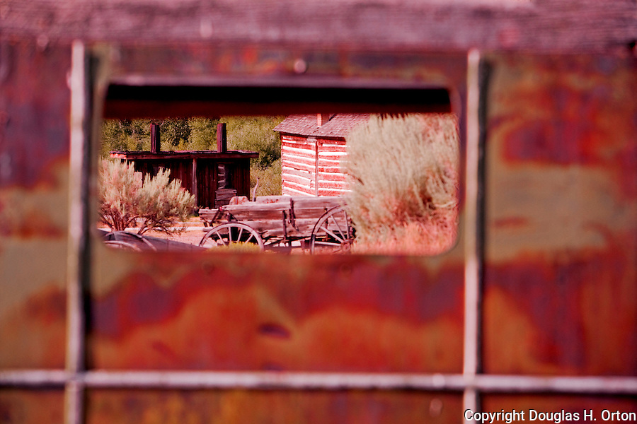 Bannack, Montana is a ghost town preserved as a Montana State Park.  Camping is peaceful, the town historic.  A remnant of Montana's gold mining history the park is west of Dillon, Montana a few miles off State Highway 278.  The jail is seen through the cab window of an abandoned truck.