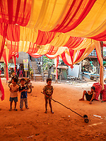 Activities and way of life, around and near the Tonle Sap Lake, Siem Reap area, Cambodia Decoration for upcoming festivities and children playing in the shade, rural area near Siem Reap at the Tonle Sap Lake, Cambodia