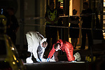 © Joel Goodman - 07973 332324 . 10/08/2017. Salford, UK. Forensic examiners examine the scene in a car park at the rear of the Ibis Hotel in Salford Quays where a young boy was killed in a collision with a car earlier this evening (Thursday 10th August 2017) . Photo credit : Joel Goodman