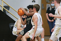 Little Rock Central Gavin Snyder (5) protects the ball, Saturday, November 14, 2020 during a basketball game at Bentonville High School in Bentonville. Check out nwaonline.com/201115Daily/ for today's photo gallery. <br /> (NWA Democrat-Gazette/Charlie Kaijo)