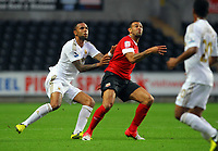 Pictured: Kyle Bartley (L) of Swansea. Tuesday 28 August 2012<br /> Re: Capital One Cup game, Swansea City FC v Barnsley at the Liberty Stadium, south Wales.