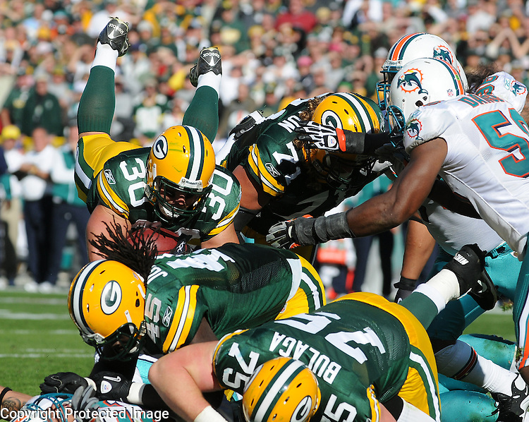 Green Bay Packers running back John Kuhn (30) is stopped short of the goal line on third and goal from the one-yard-line against the Miami Dolphins late during the fourth quarter of the game at Lambeau Field in Green Bay, Wis., on Oct. 17, 2010.